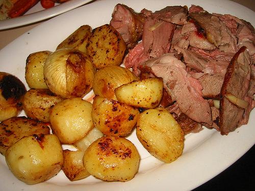 Roast lamb, potatoes and onions