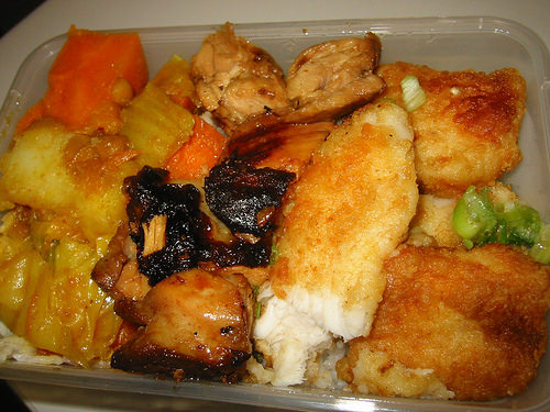 Rice, curried vegetables, Malay chicken and panfried fish