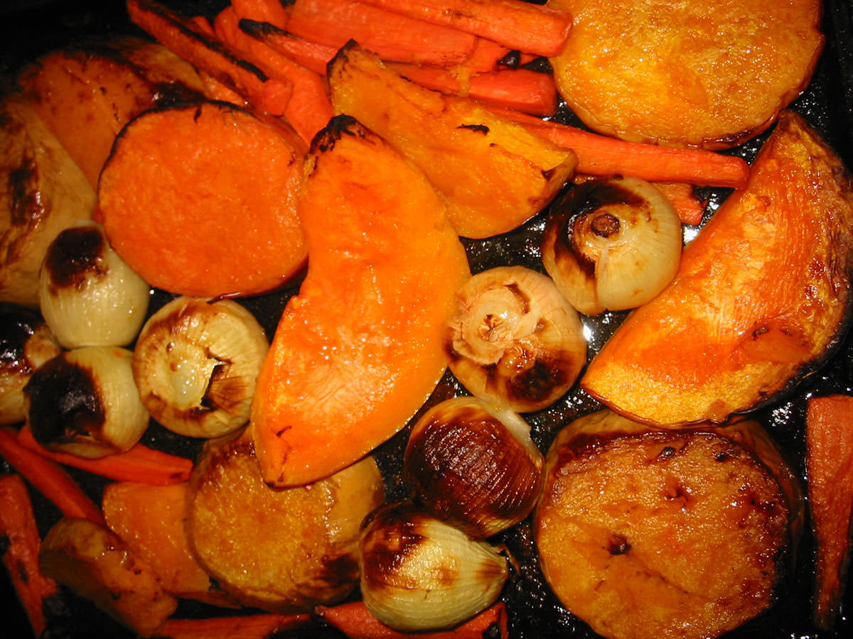 Roast pumpkin, onions and carrots in oven tray