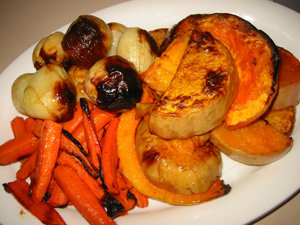 Roast pumpkin, onions and carrots on serving dish