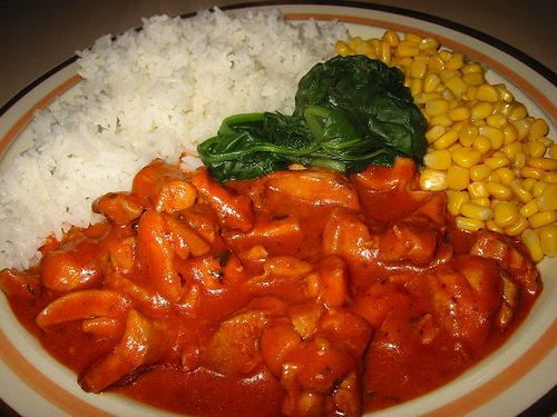 Butter chicken, spinach, corn kernels and rice