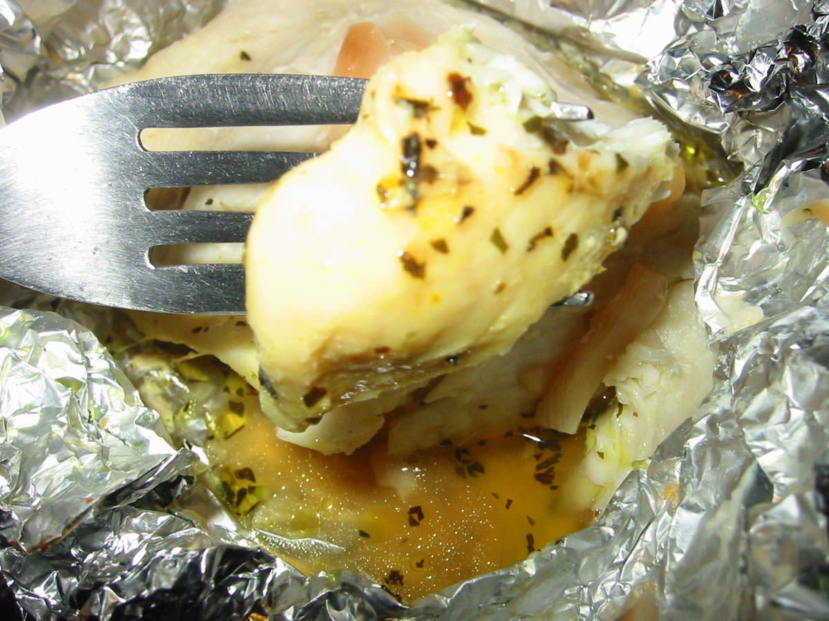 Baked fish with garlic, herbs and butter