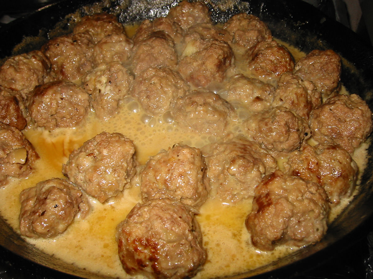 Meatballs bubbling in cream sauce
