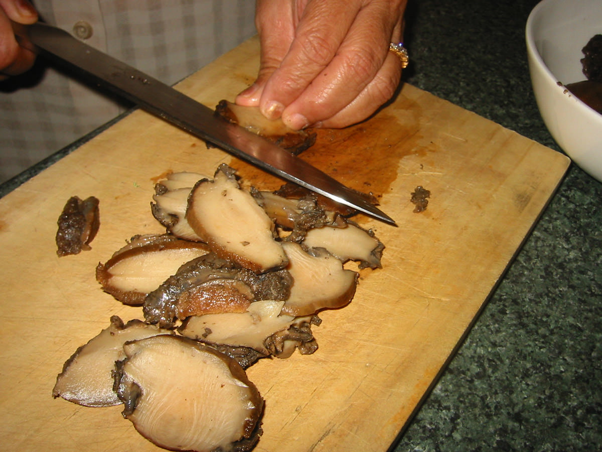 Slicing the cooked abalone