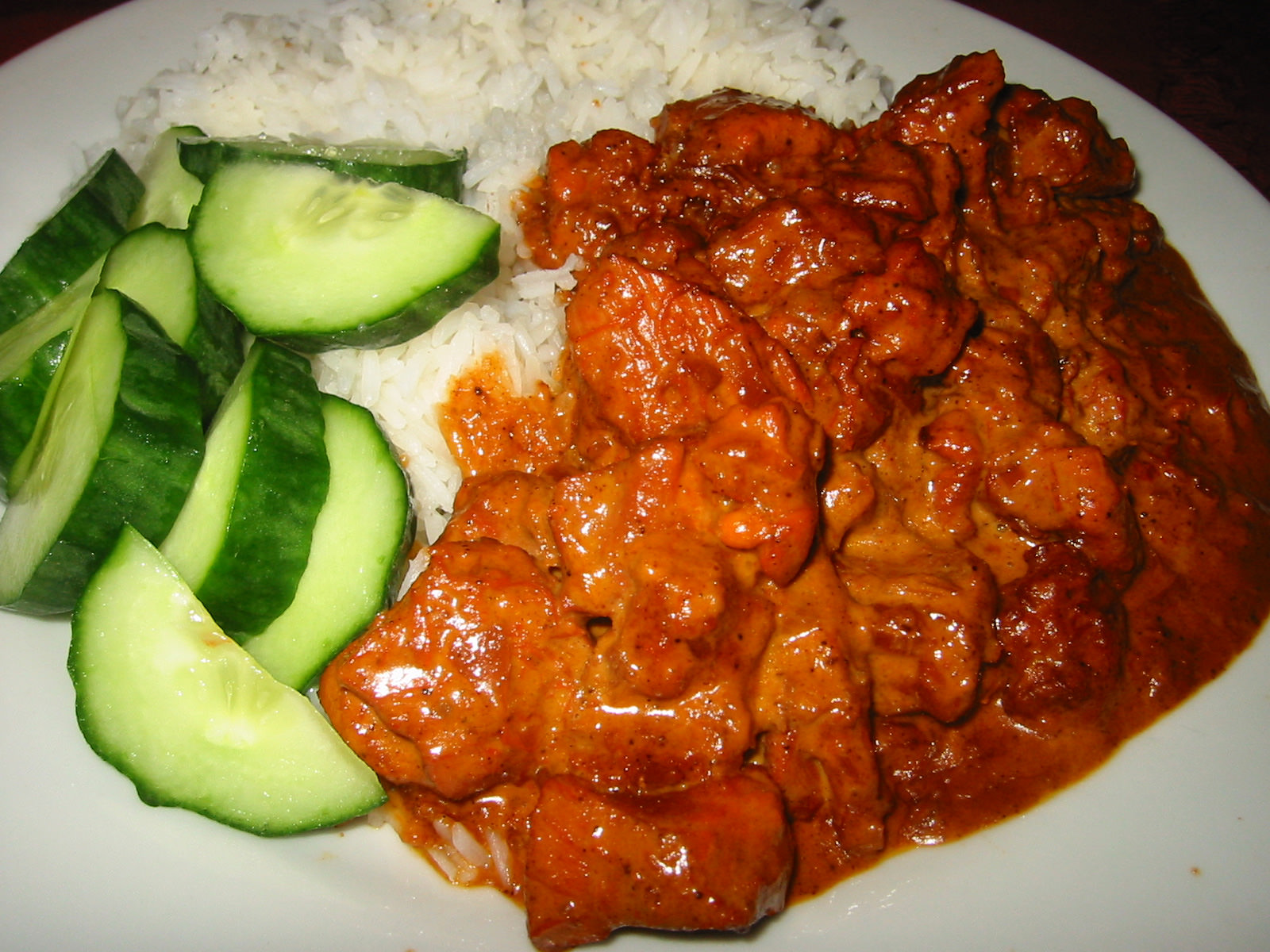 Butter chicken, cucumber, and rice