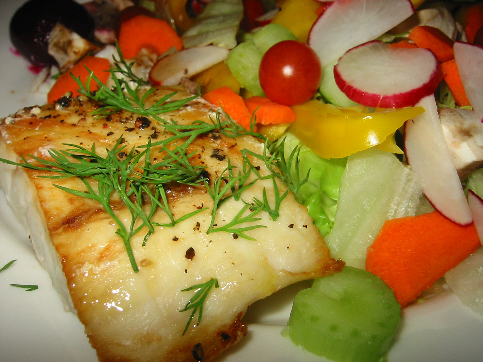 Grilled barramundi topped with fresh dill