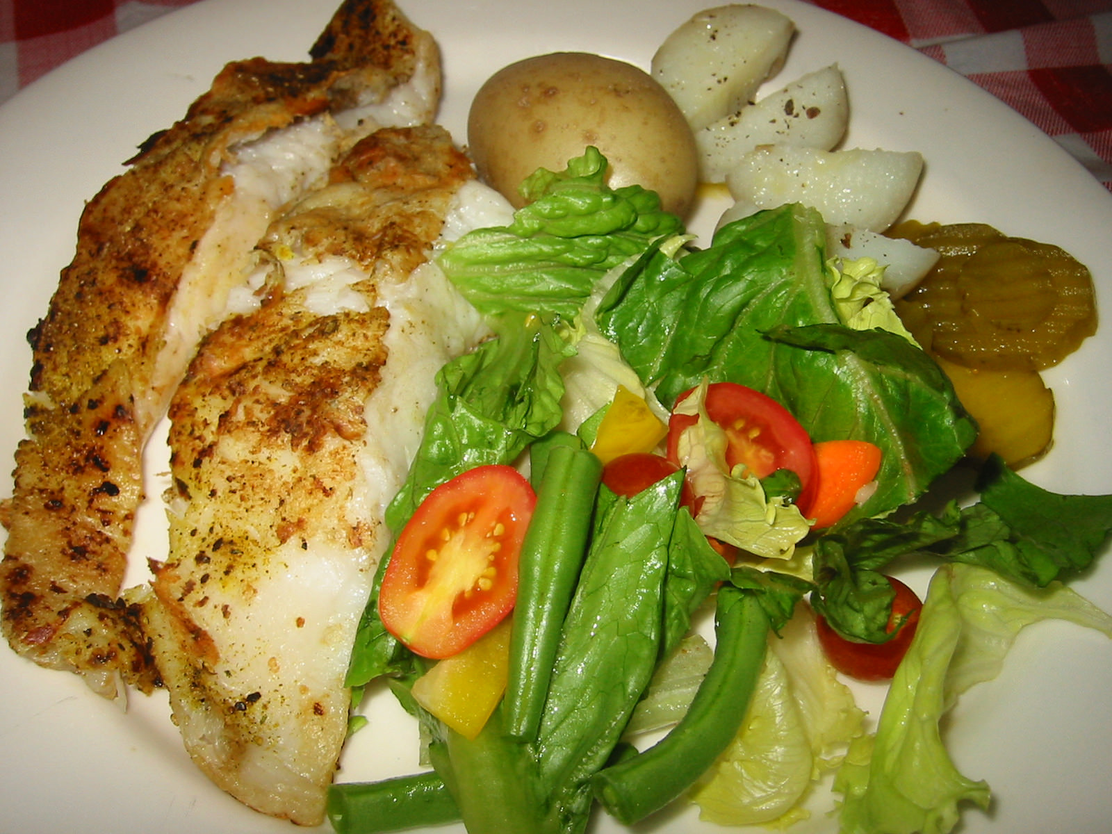 Grilled barramundi, potatoes, salad and pickles