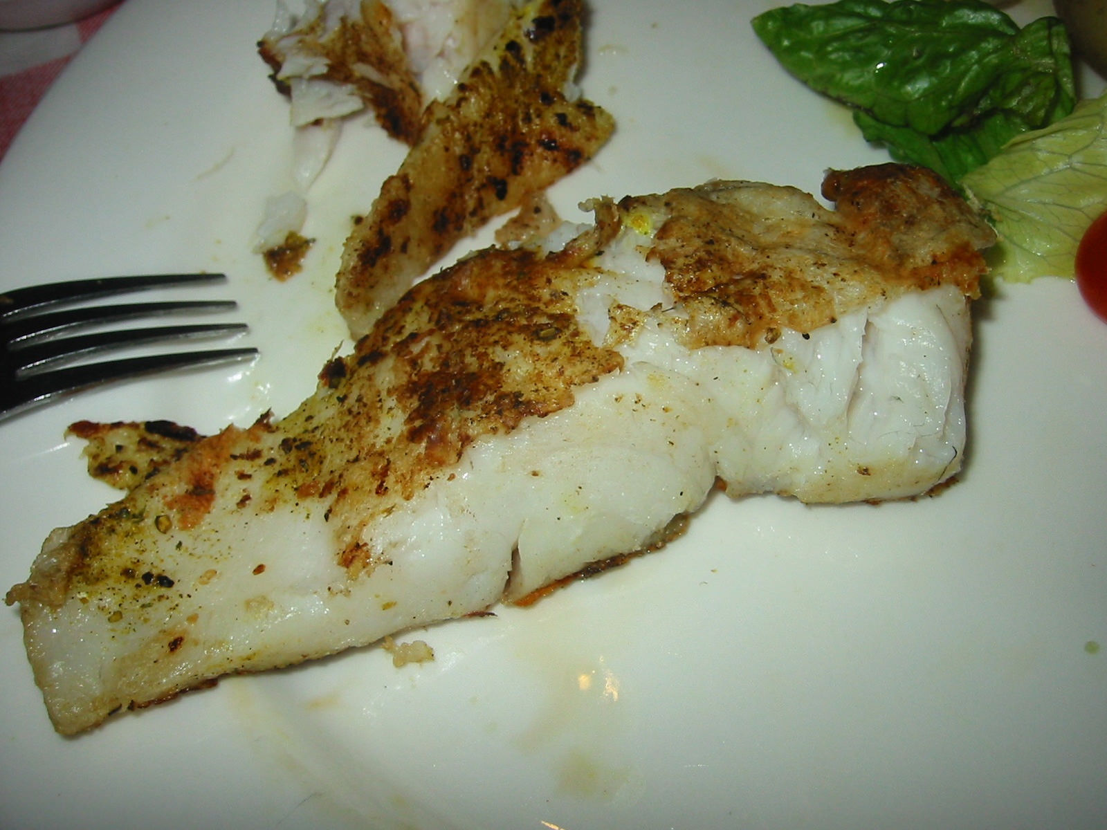 Close-up of grilled barramundi