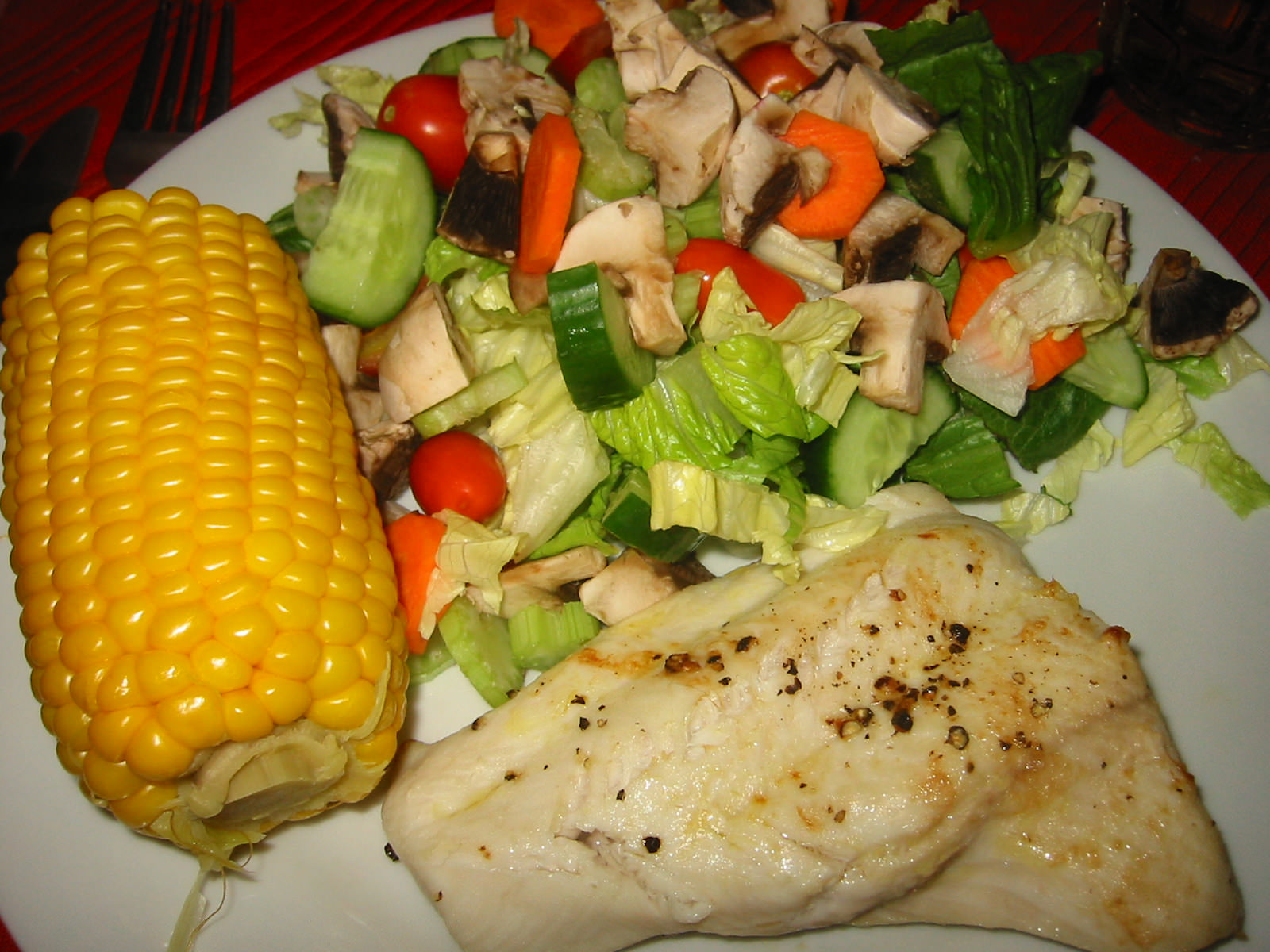 Grilled shark, salad and corn
