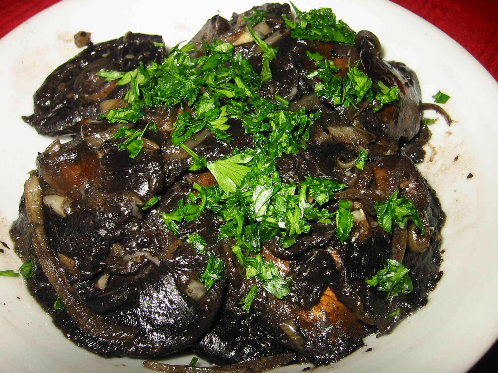 Grilled garlic and onion mushrooms topped with fresh parsley