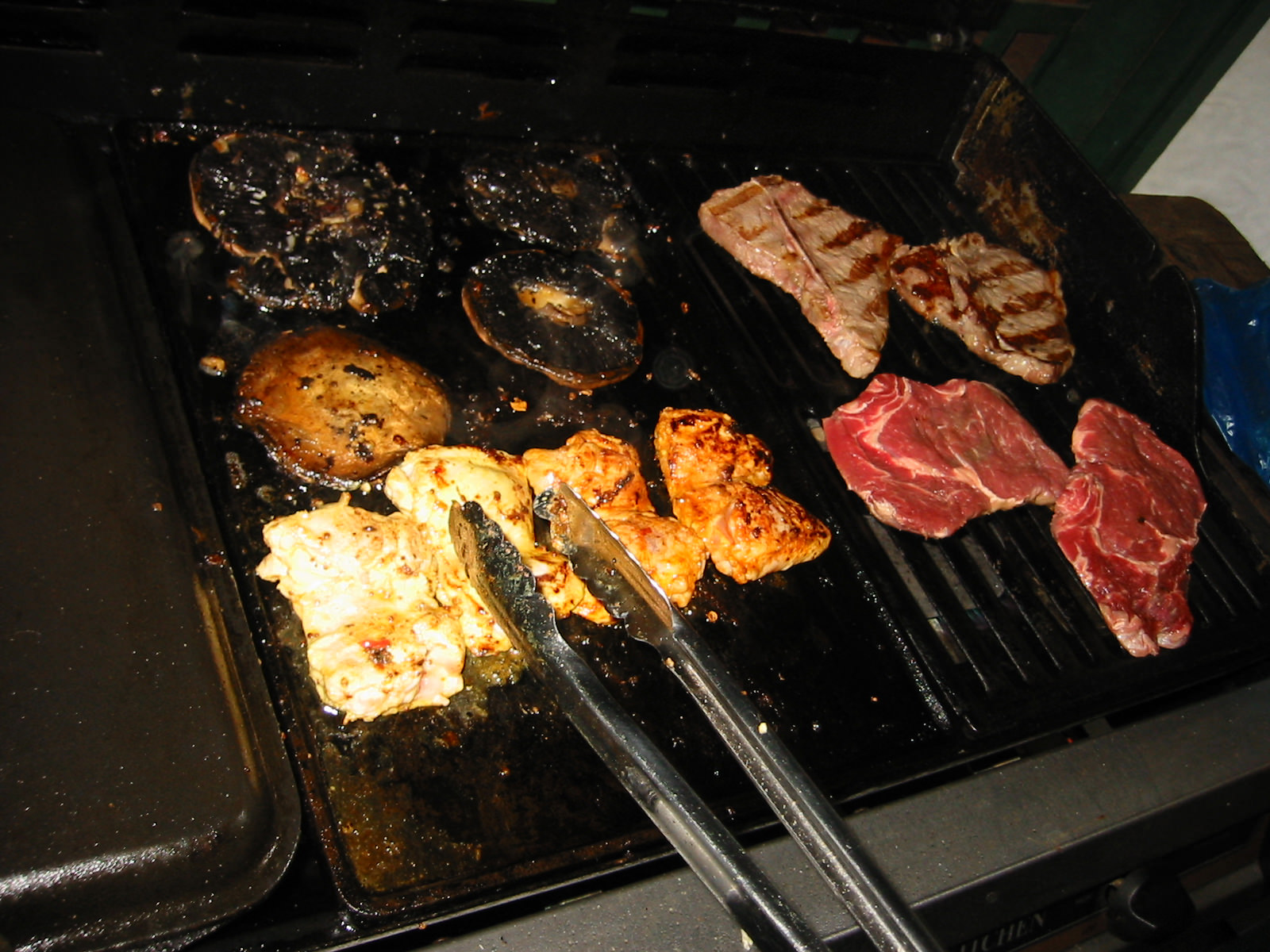 Mushrooms, chicken and steak on the barbie
