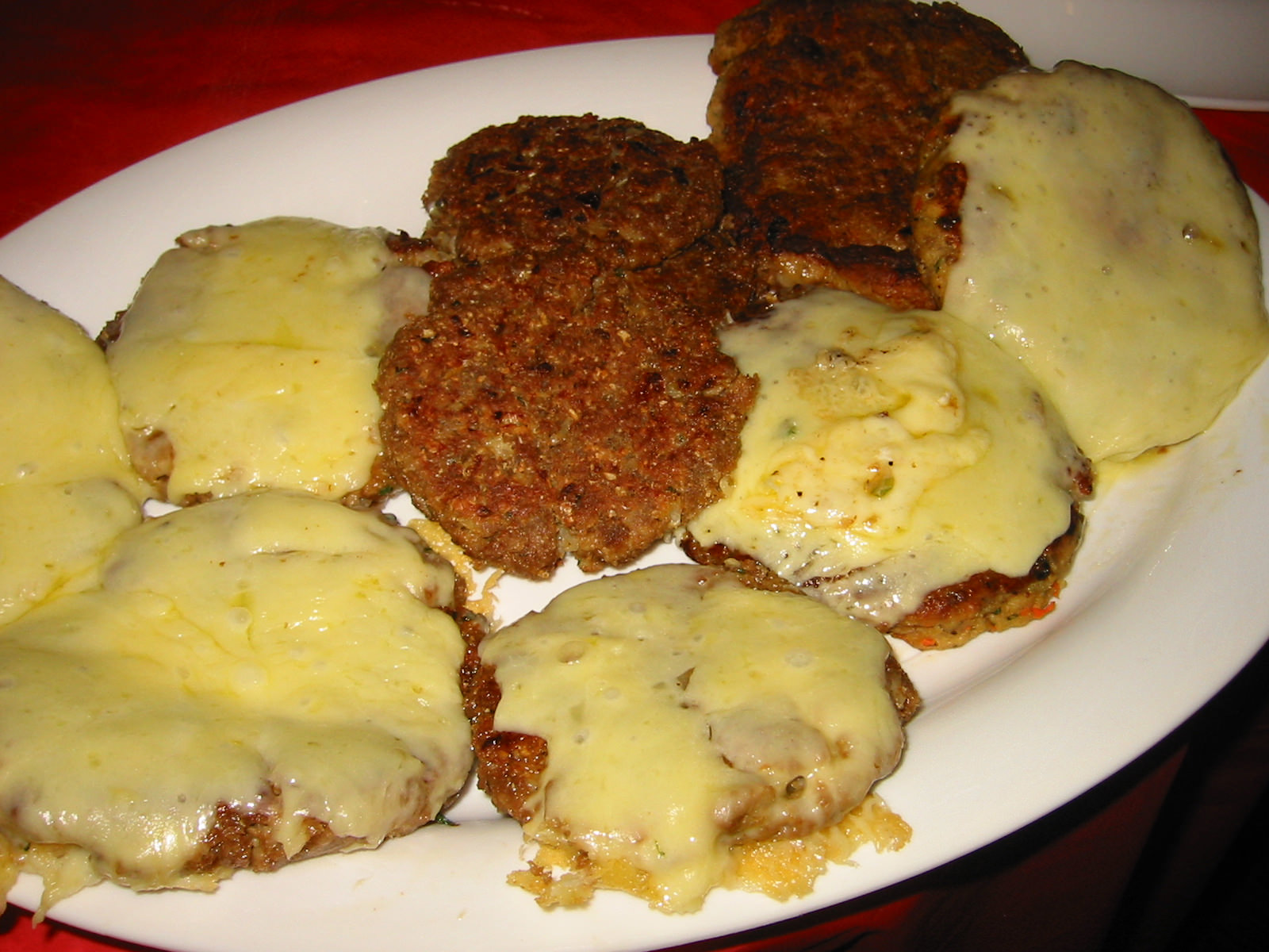 Burger patties, some with cheese, some vegetarian
