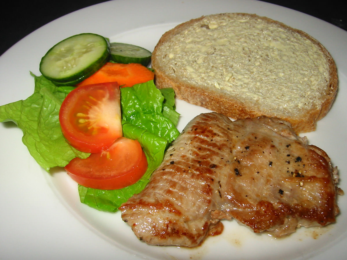 Turkey steak, salad and buttered bread