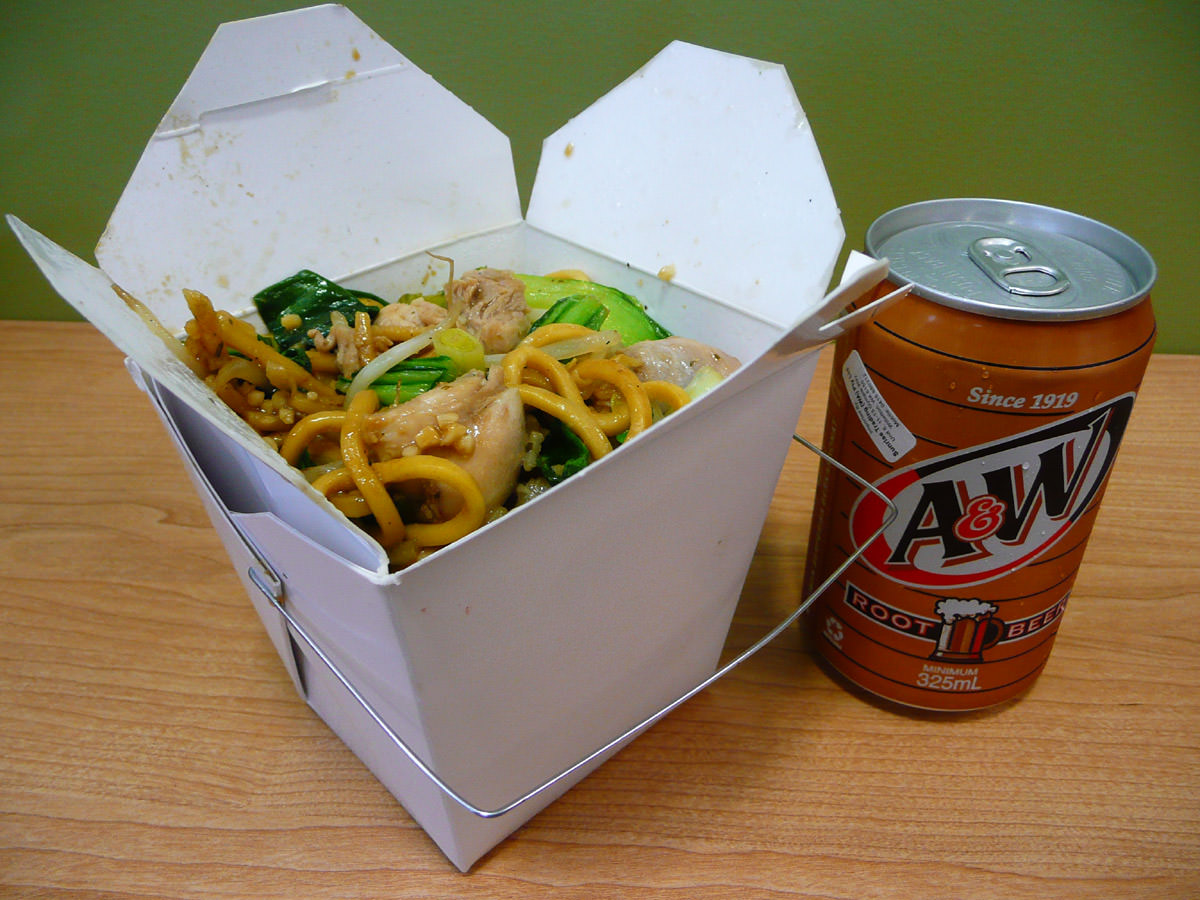 A box of noodles - opened - and a can of root beer