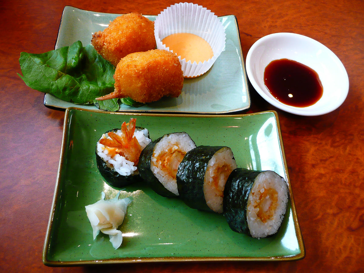 Crumbed prawn sushi and crab claws