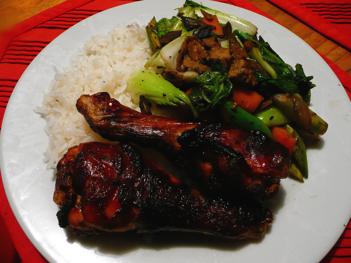 Soy honey chicken drumsticks with stir-fried vegetables and rice