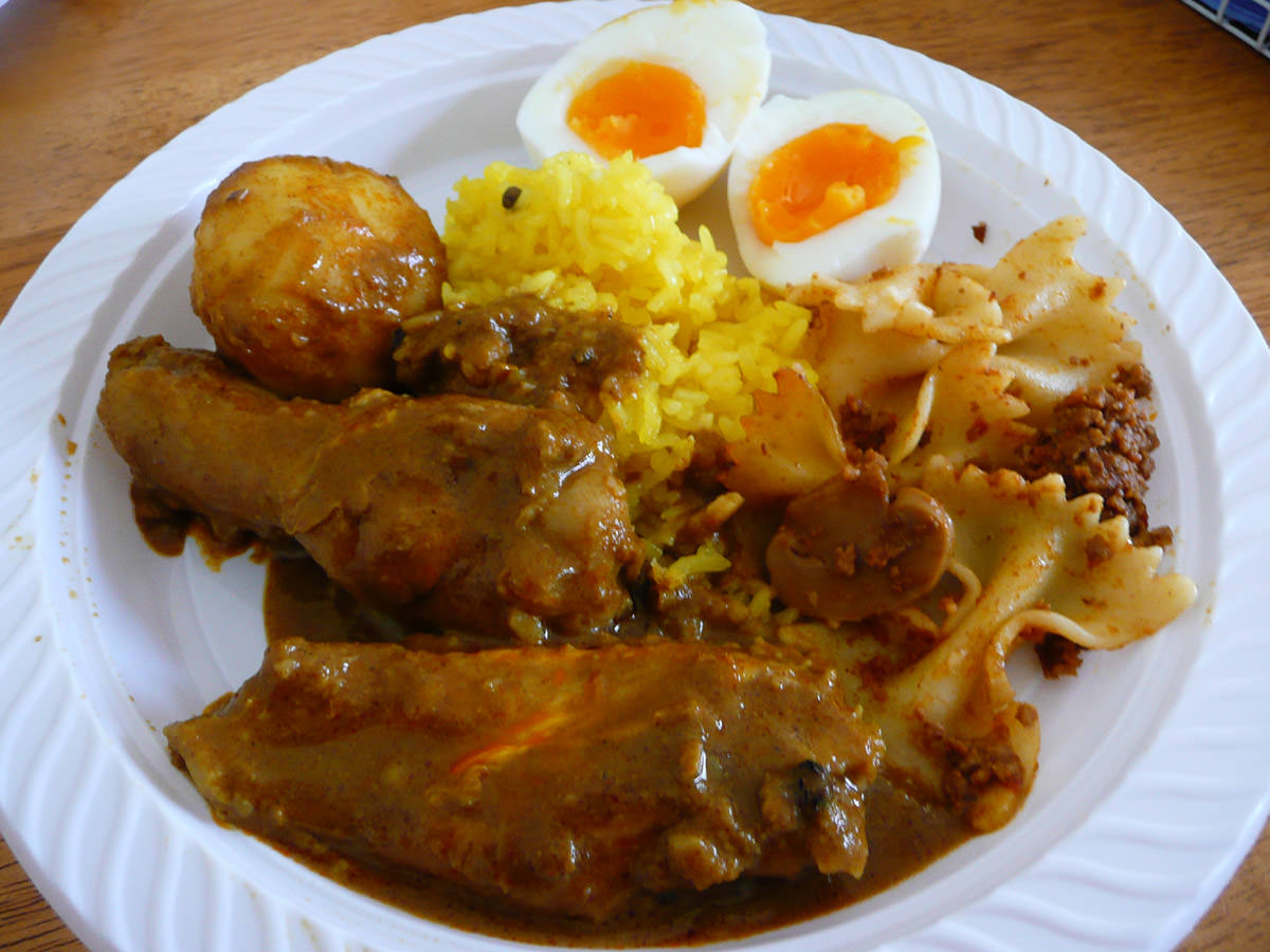 My plate - nasi kunyit and curry chicken with red egg peeled