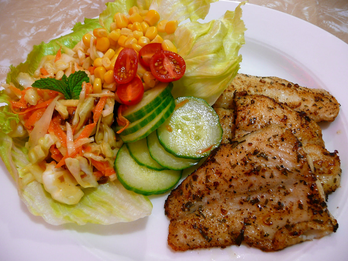 Panfried basa fillets with coleslaw and salad