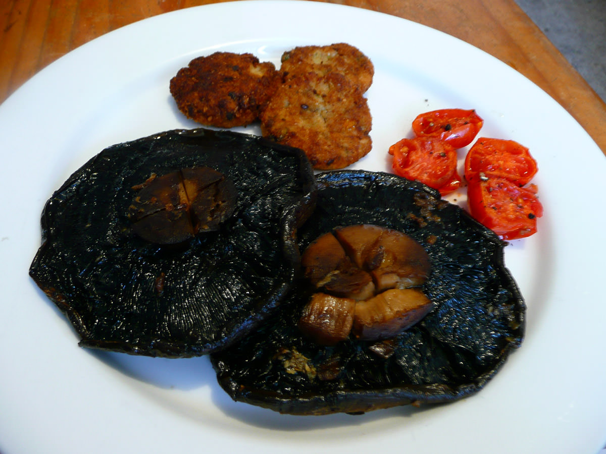Grilled garlic portobello mushrooms, grilled cherry tomatoes and fish cakes