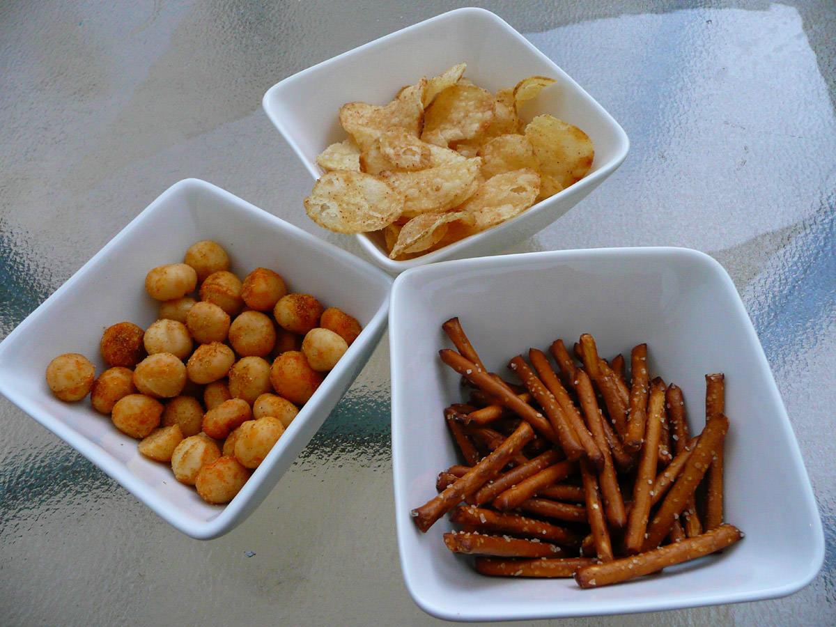 Macadamias, crisps and pretzel sticks