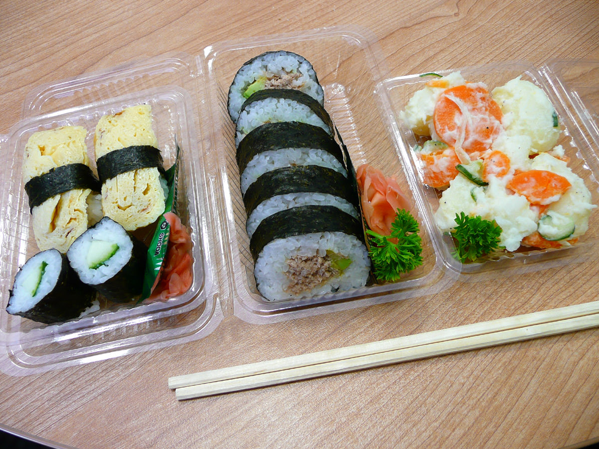 Tamago sushi, mini cucumber sushi, cooked tuna sushi and potato salad