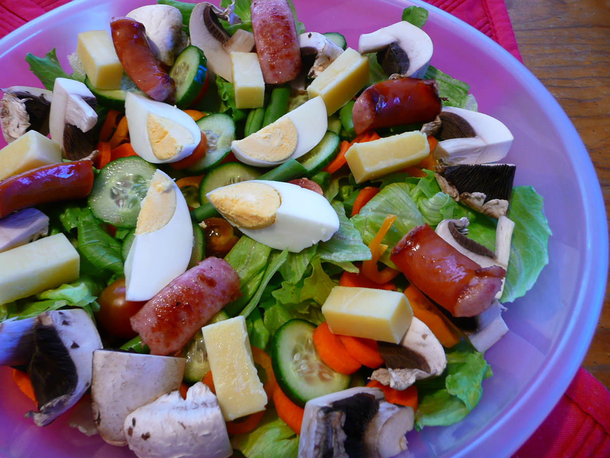 Salad with hard-boiled egg, tasty cheese and fried cabanossi