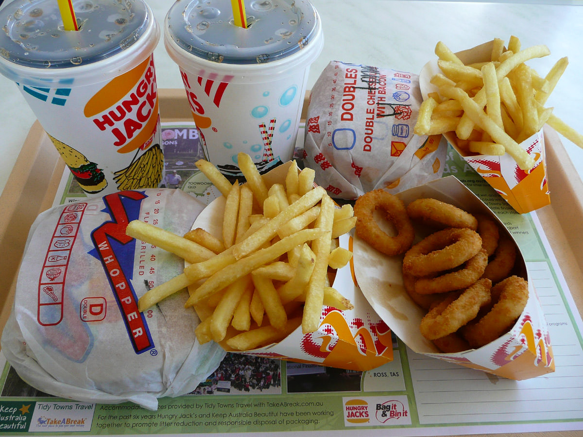 Burgers, fries, onion rings and drinks