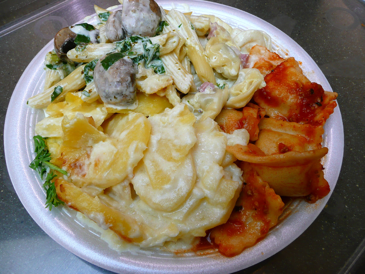 Potato bake, mushroom and spinach penne in a creamy sauce, tortellini in a creamy sauce with ham, and ravioli bolognaise