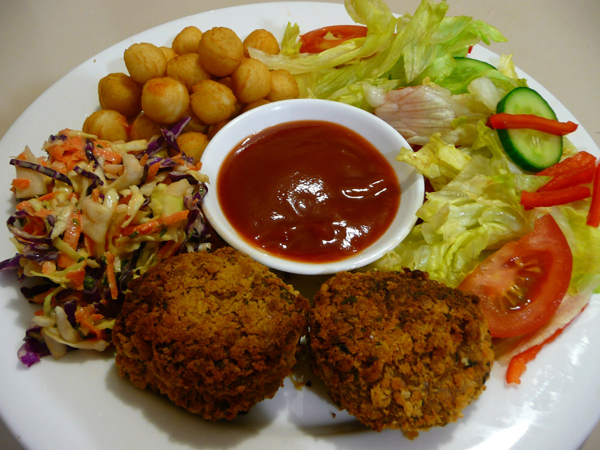 Chicken patties, coleslaw, salad and pommes noisettes