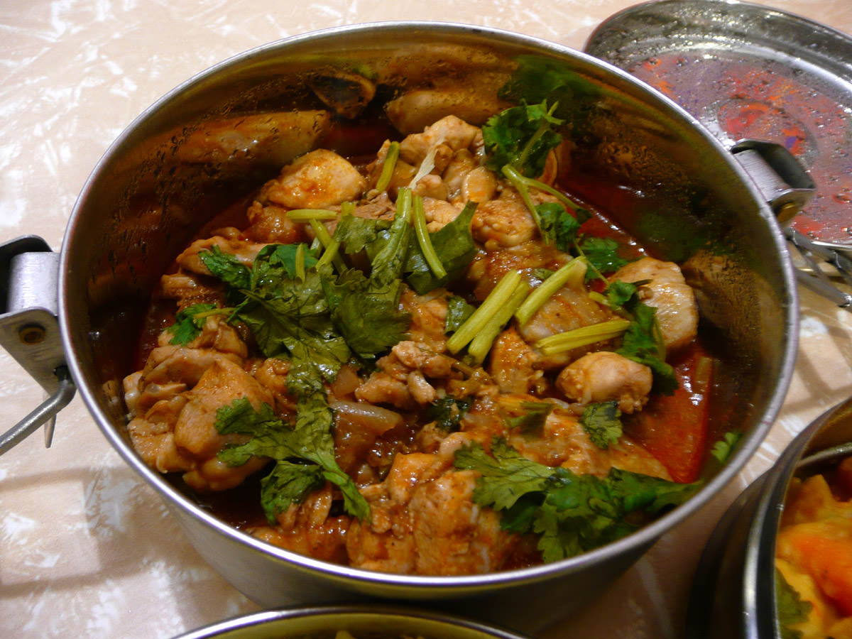 Chicken in honey and tomato with spices