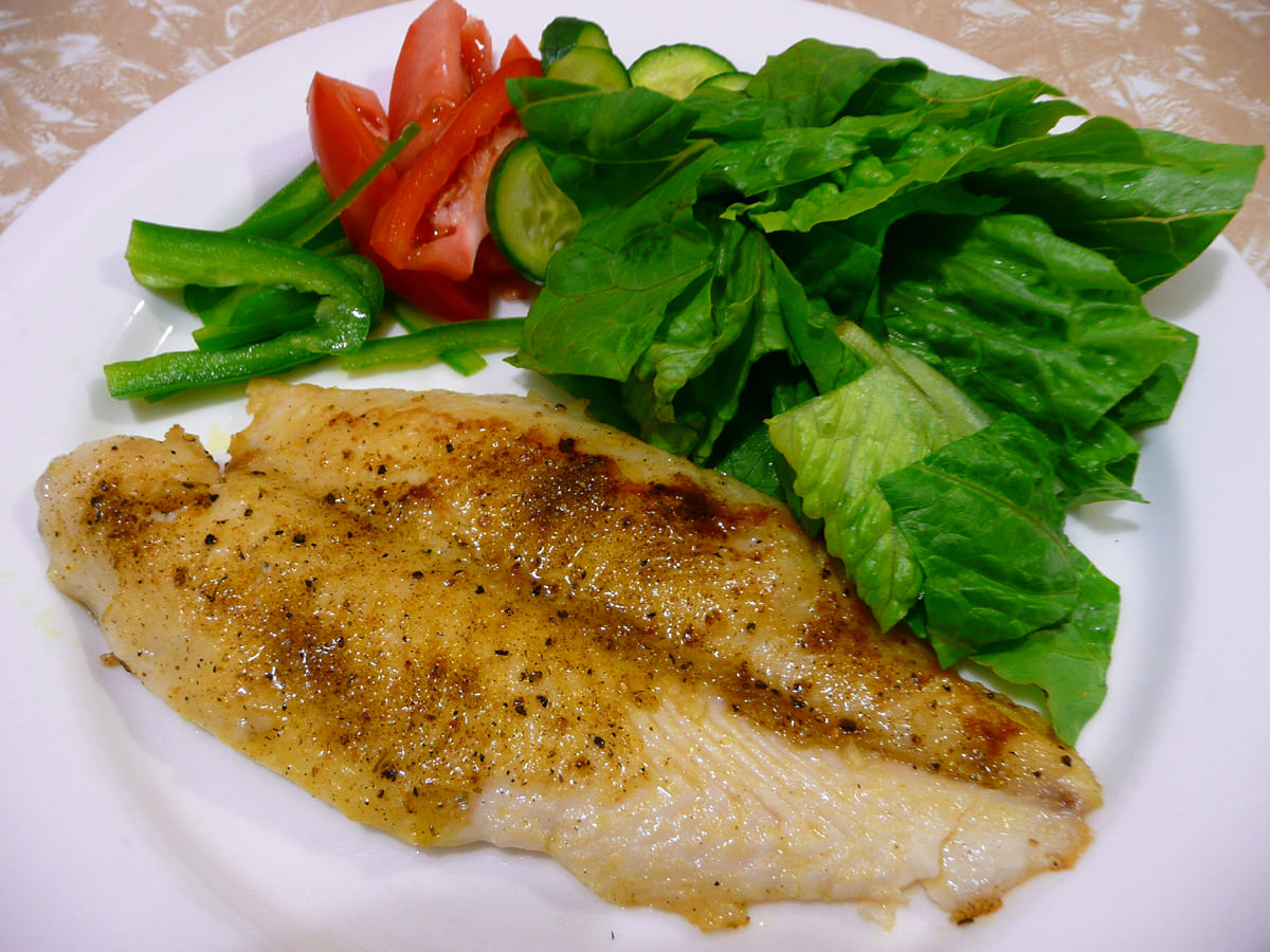 Lemon pepper-rubbed fish with salad
