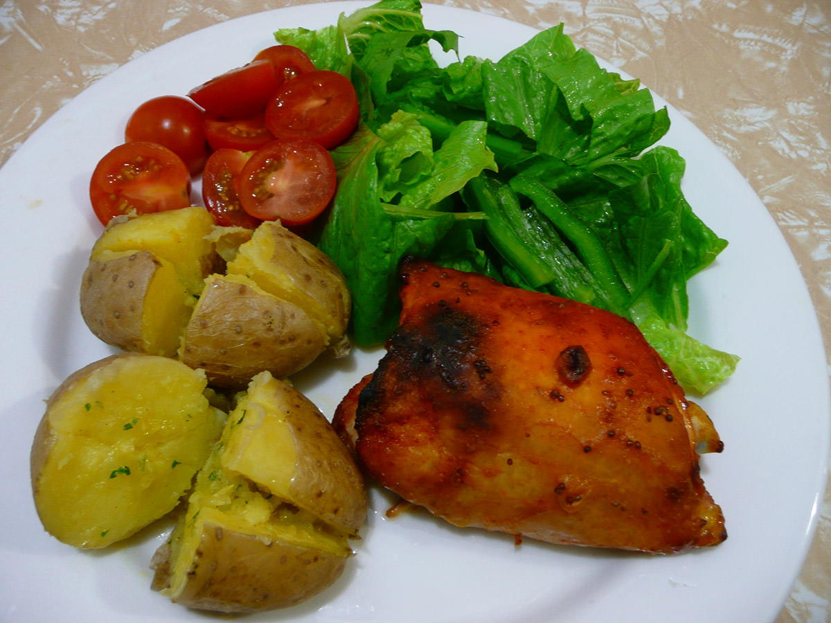 Honey and mustard chicken, baked potato with garlic butter and salad