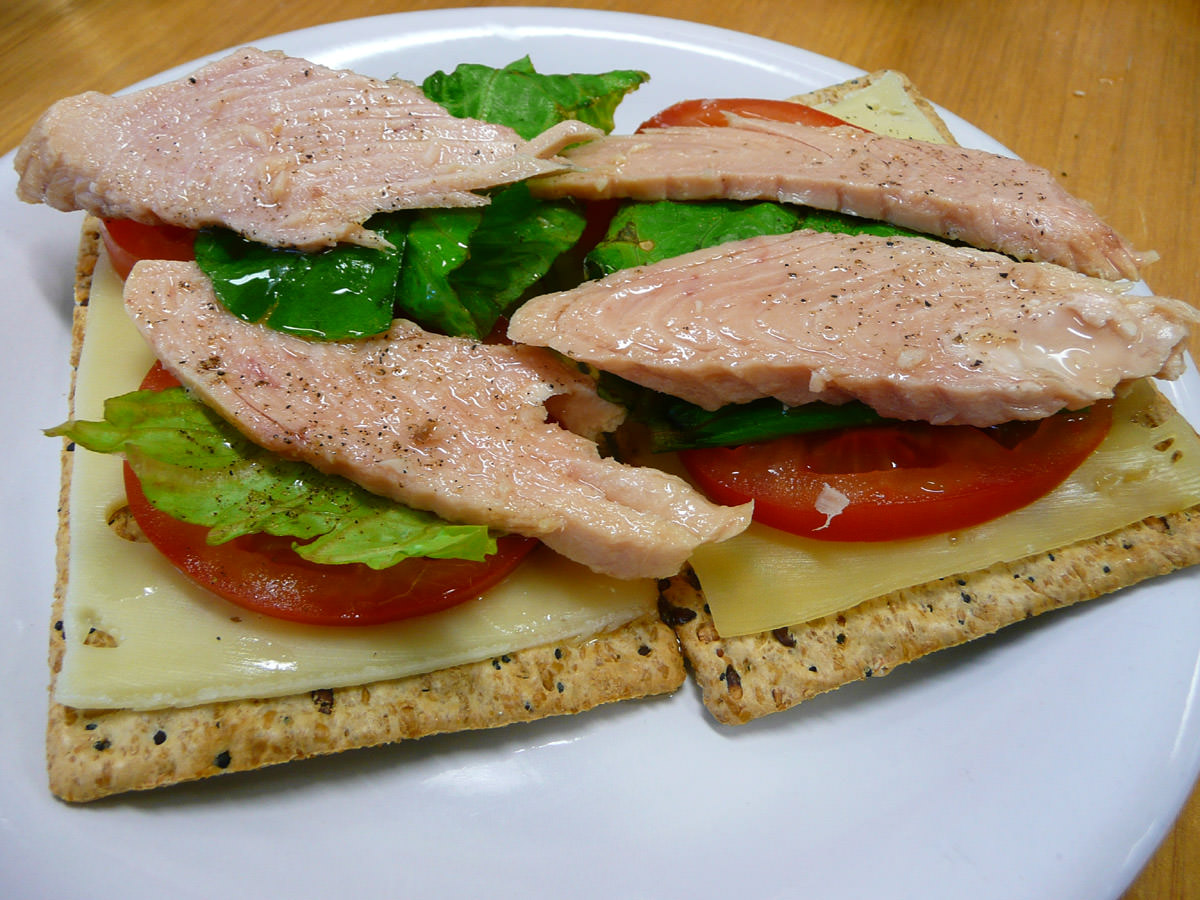 Tuna, lettuce, tomato and swiss cheese on crackers
