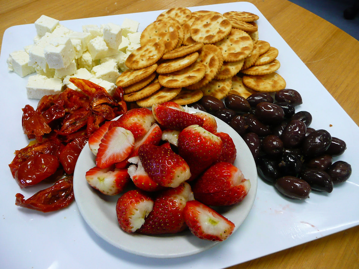 Semi-sundried tomatoes, feta, Ritz crackers, olives and strawberries