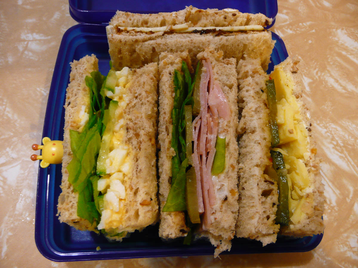 Four different dainty sandwiches