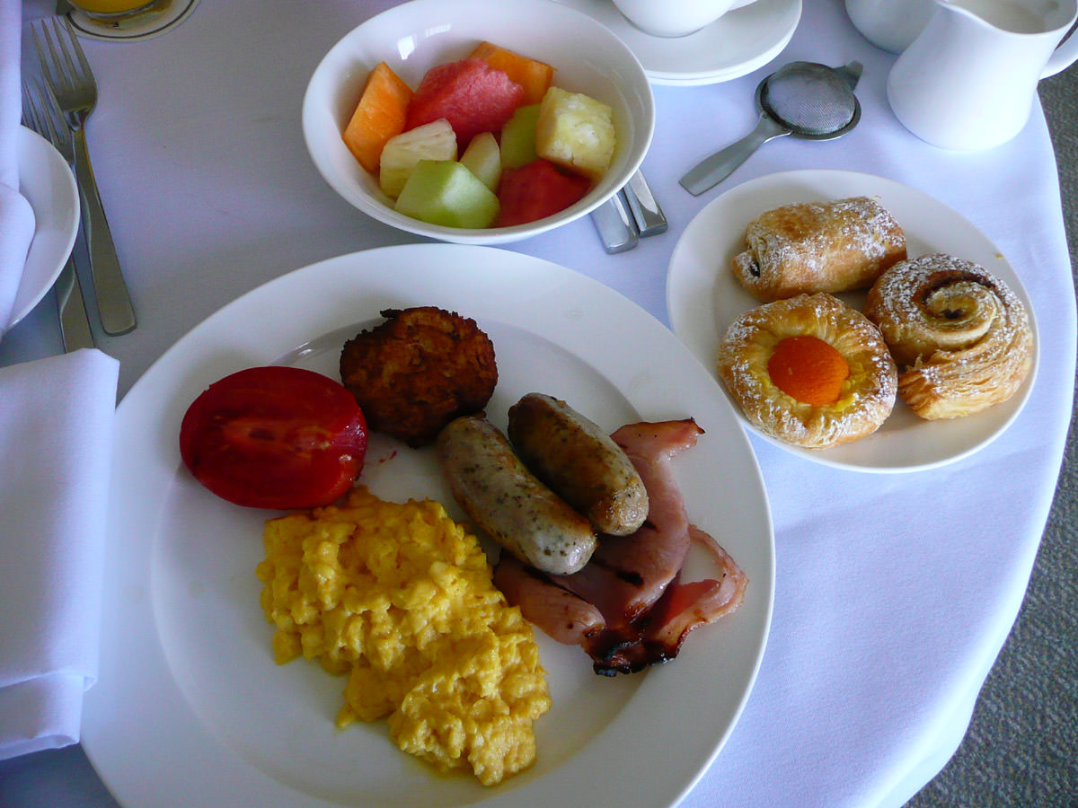 My plate, fresh fruit and selection of danishes