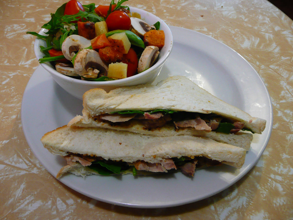 Roast pork and spinach sandwich, with rocket, spinach and roasted root vegetable salad