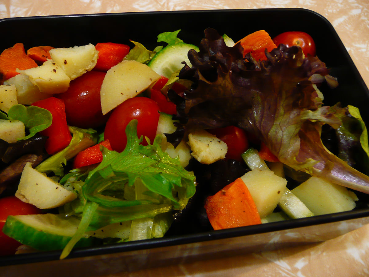 Salad with cubes of oven-baked potato and sweet potato
