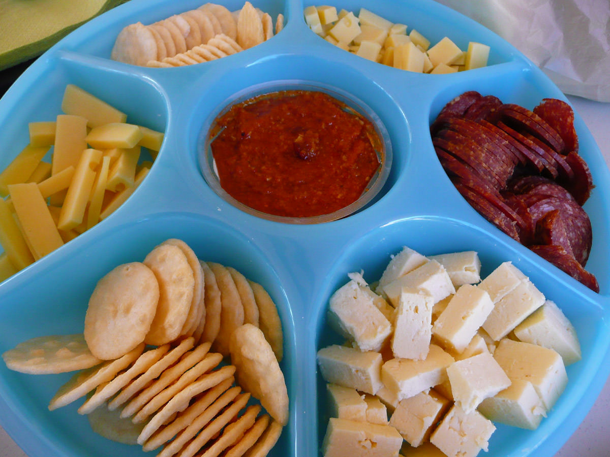 Crackers, cheese, salami and dip