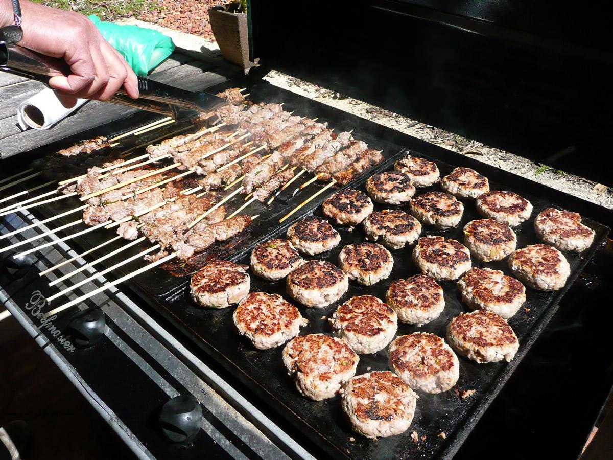 Lamb skewers and hamburgers