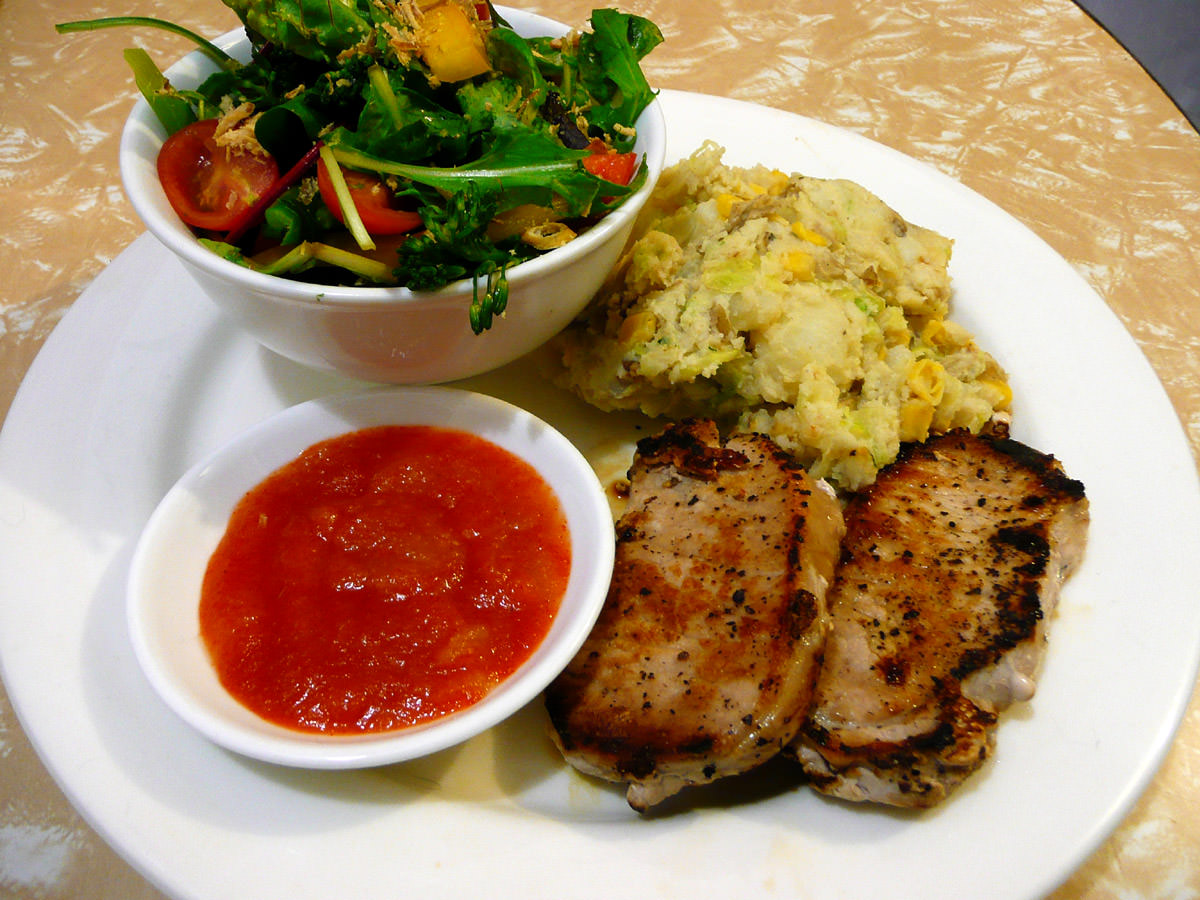 Pork steaks, bubble and squeak, salad and chilli sauce