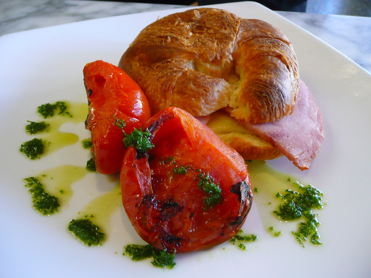 Ham and cheese croissant with tomato