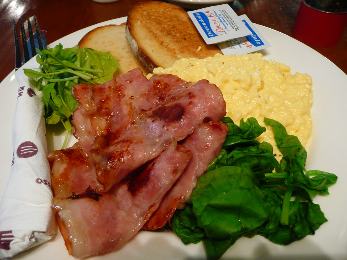 Bacon, scrambled eggs, spinach, toast