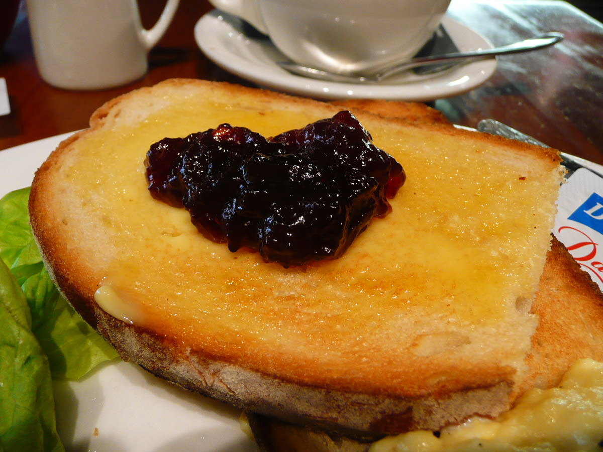Strawberry jam on buttered toast