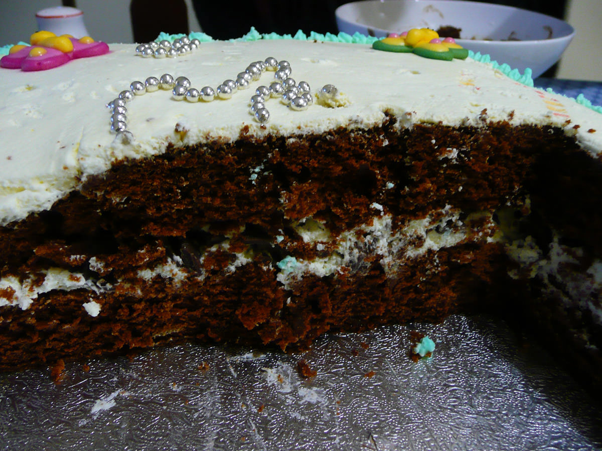 Savannah's birthday cake innards - with a layer of cream and chocolate bits in the middle