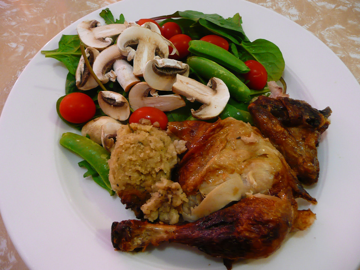 Barbecue chicken, stuffing and salad