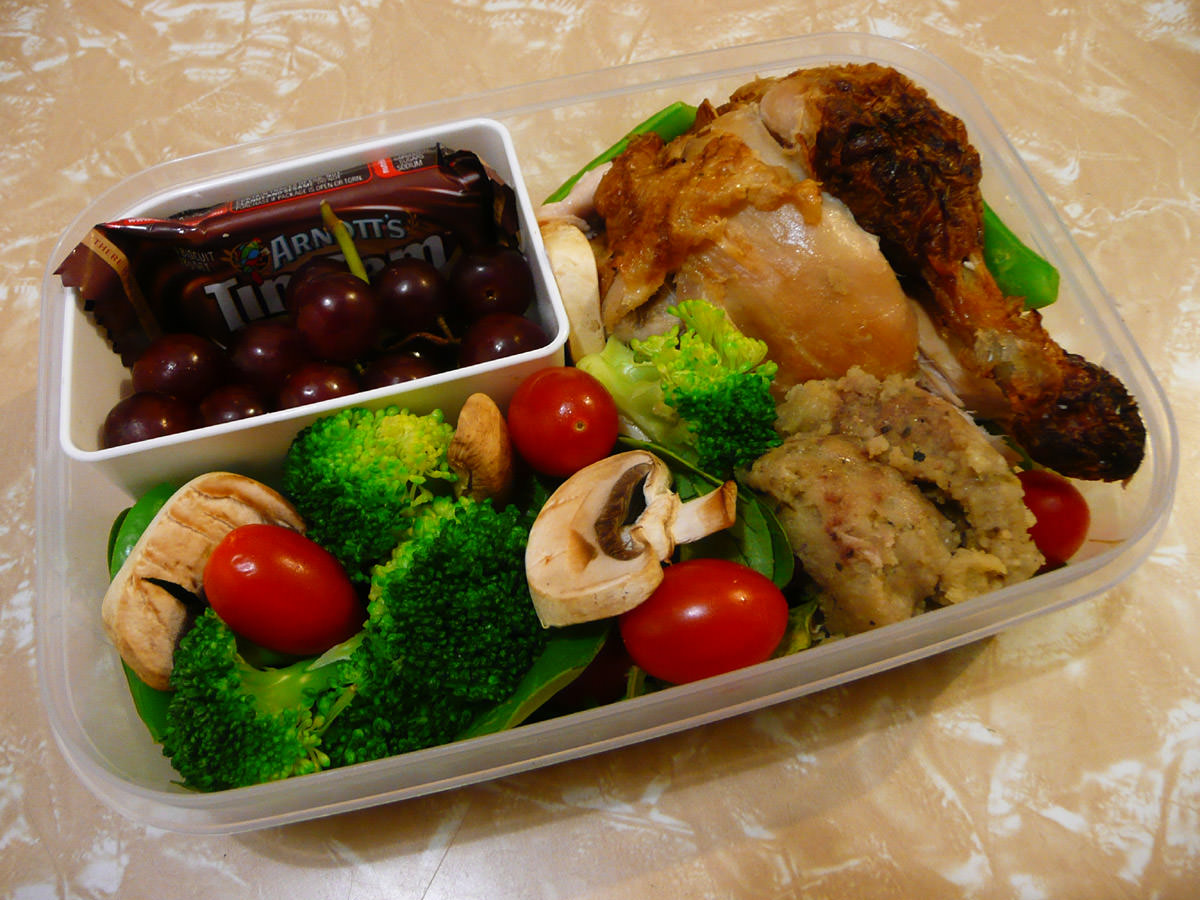 Bento - barbecue chicken, stuffing, salad, grapes and Tim Tam