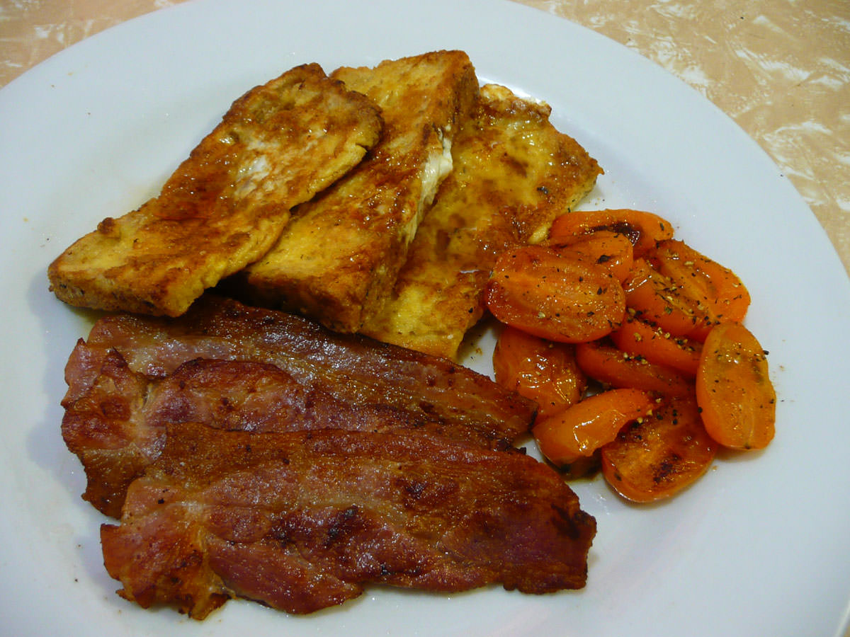 Bacon, French toast and golden tomatoes