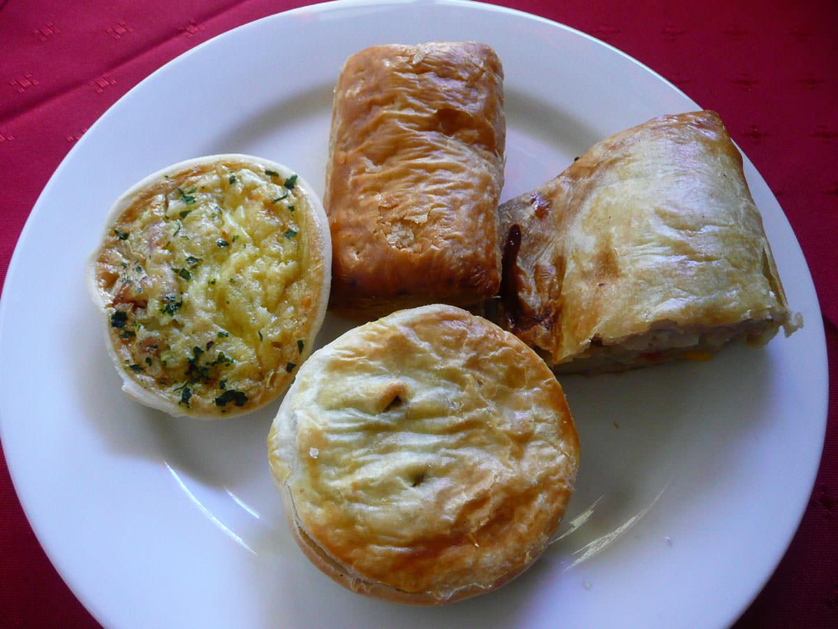 Mini pie, sausage roll, quiche and a pastie