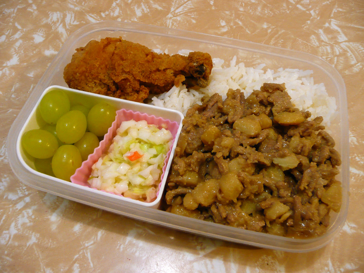 My Christmas eve bento - turkey minchee, rice, KFC Original Recipe drumstick, KFC coleslaw and seedless green grapes